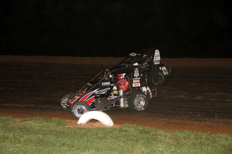 Bell and Clauson racing for the at Belleville