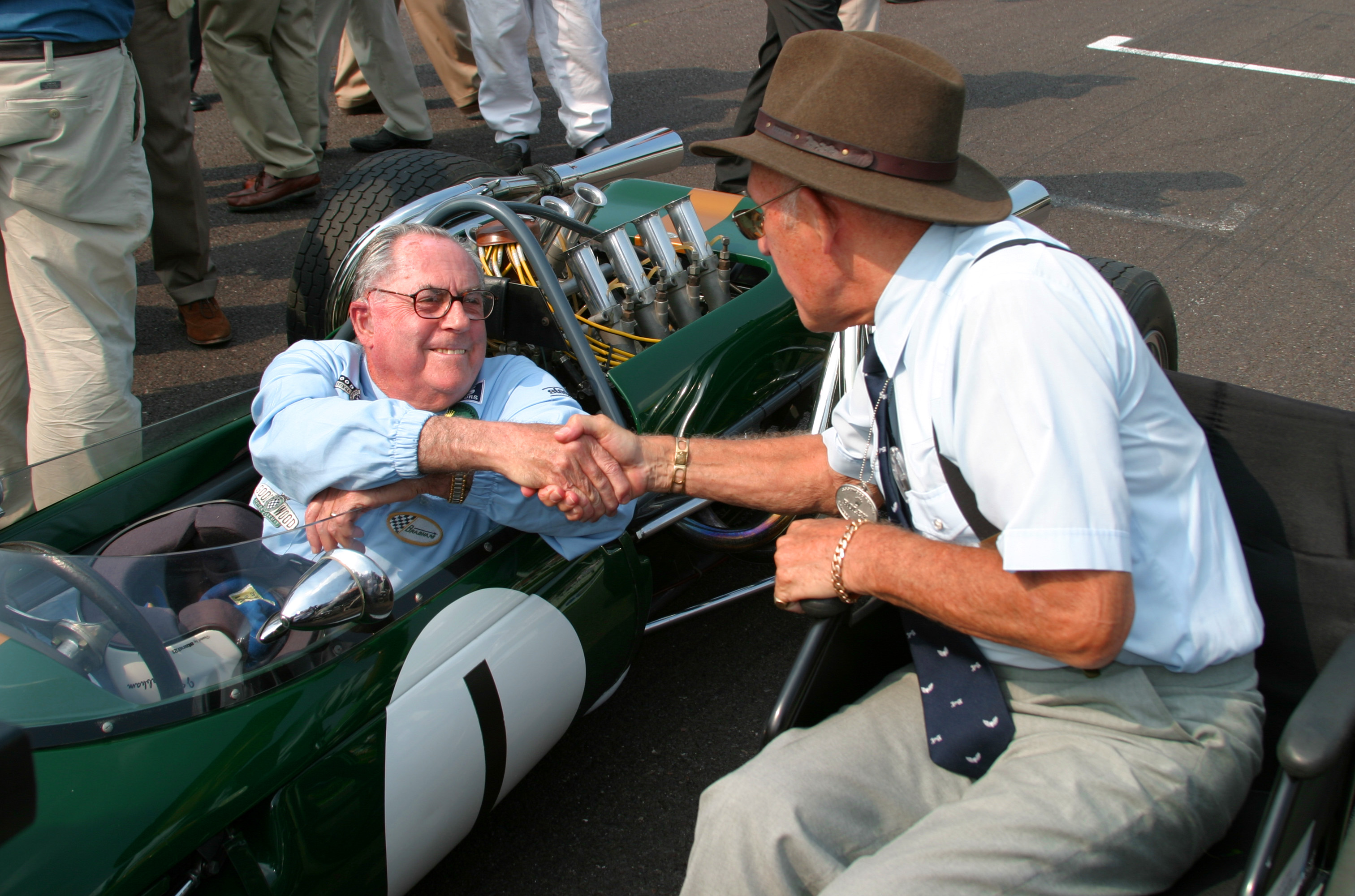 Sir Jack and Sterling Moss with the Brabham BT19 at Goodwood