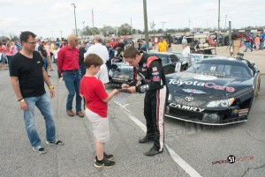 Bell signing for fans after Rattler 250 win  Pic - Speed51.com